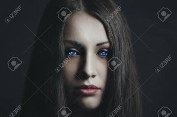 Dark portrait of beautiful girl with strange eyes. Surreal and alien